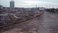 The derelict remains of Dundee Tay Bridge Goods looking east with the station off to the left. The site is now obliterated under the re-aligned A85, a nearby supermarket and car parks.<br><br>[Ewan Crawford&nbsp;18/01/1989]