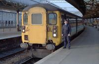 The driver of an Aberdeen-Glasgow train poses by his charge before departure. 47 703 <i>St Mungo</i> was at the rear.<br><br>[Ewan Crawford&nbsp;25/01/1989]