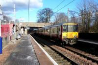 The 14.15 Glasgow Central to Ardrossan (318 266) runs into Lochwinnoch on 12 February 2010.<br><br>[Colin Miller&nbsp;12/02/2010]