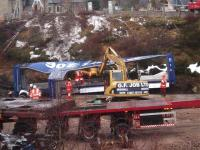 Some of the remaining badly damaged containers being cut up at Carrbridge on 14 February 2010.<br><br>[Gus Carnegie 14/02/2010]