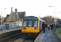 A Manchester to Southport service in the hands of Northern Rail 142005 calls at Appley Bridge late in the afternoon of 10 February 2010. The original station building stands on the Up platform although now in use as the 'Station Bar'.... could be worse..<br> <br><br>[John McIntyre&nbsp;10/02/2010]