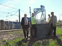ScotRail's external relations manager John Yellowlees, Bill Thomson and Neil Fraser from the Rotary Club of Portobello, and artist Kenny Munro, with the new sculpture at Newcraighall station. [See news item]<br><br>[ScotRail&nbsp;29/05/2012]