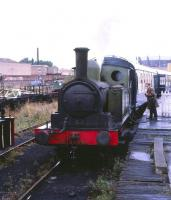 <I>Excuse me, but isn't this a record...  </I>Layerthorpe station, York, on the Derwent Valley Light Railway, in 1979. Worsdell ex-NER Clas E1 (LNER Class J72) no 69093 <I>Joem</I> takes on water via the platform hosepipe. Some 113 examples of this sturdy and reliable class were built in 9 batches over an elapsed period of 53 years between 1898 and 1951, a record production span for a British steam locomotive. <br><br>[Peter Todd&nbsp;../../1979]