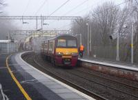 320 302 with a Helensburgh - Drumgelloch service at Dalreoch on 17 February<br><br>[David Panton&nbsp;17/02/2010]