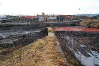 The roadbridge to the west of the former Westcraigs station is being re-built. This view is from the old loading bank. [See image 25382]<br><br>[Ewan Crawford&nbsp;17/02/2010]