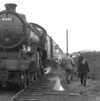 'See when I say <I>get back on the train</I>....'  The persuasive looking gentleman moving threateningly towards the photographer appears keen to commence the next leg of the <I>Scottish Rambler No 5</I> railtour which is preparing to leave Girvan goods behind B1 no 61342 on 10 April 1966.... and what's that in his left hand...no, surely not!  Anyway... I understand everyone got back on the train at this point. <br> <br><br>[K A Gray&nbsp;10/04/1966]