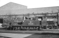 Scene on Gateshead shed in 1965, with J72 0-6-0T no 69005, a regular station pilot across the Tyne at Newcastle Central, standing in front of Thompson B1 4-6-0 no 61019 <I>Nilghai</I>.<br><br>[K A Gray&nbsp;//1965]