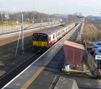 Most trains at Cardonald are whoosing through on their way to and from Ayrshire destinations running non-stop between Glasgow and Paisley, managing briefly to drown out the roar of the M8 which runs parallel to <br> the lines.� Every hour however two of the three services to Gourock call <br> at the (almost) inseparable trio of Cardonald, Hillington East and <br> Hillington West.� On 17 February 314 209 pulls in heading west.<br> <br><br>[David Panton&nbsp;17/02/2010]