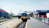 A much diminished Pwllheli terminus, seen in July 1991, with DMU 150 001 at the platform.<br><br>[Colin Miller&nbsp;/07/1991]