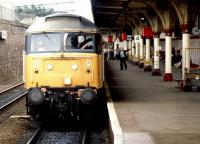 The driver of a class 47 gets a green flag and a stiff neck at Dundee station in April 1987 as he prepares to take out an Aberdeen - Glasgow Queen Street service. <br><br>[John Furnevel&nbsp;25/04/1987]