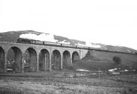 A2 Pacific no 60528 <I>Tudor Minstrel</I> takes The Warwickshire Railway Society 'Waverley Railtour' north onto Shankend viaduct in December 1965.<br><br>[Robin Barbour Collection (Courtesy Bruce McCartney)&nbsp;11/12/1965]