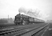 Royal Scot 4-6-0 no 46152 <I>The King's Dragoon Guardsman</I> passing Kingmoor on 23 January 1965 with the 9.25 am Crewe - Perth which it had taken over at Carlisle. The locomens hostel stands in the left background.<br><br>[Robin Barbour Collection (Courtesy Bruce McCartney)&nbsp;23/01/1965]