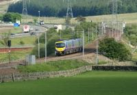 A southbound First TransPennine Express service for Manchester Airport running south parallel with the M74 towards Beattock Summit from Elvanfoot on 1 June 2009 <br> <br><br>[John McIntyre&nbsp;01/06/2009]