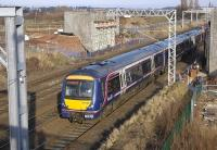 170402 on an Edinburgh-Glasgow Queen Street service on 21 February passes the abutments of the tramway bridge currently being built across the tracks at Saughton.<br> <br><br>[Bill Roberton&nbsp;21/02/2010]