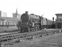 Jubilee no 45663 <I>Jervis</I> arrives at Doncaster station on 20 July 1963 hauling the 1.48pm Skegness - Hebden Bridge. Note the changing skyline around the distinctive <I>Church of St James, Doncaster</I>, in the background. The 1858 church, built to cater for the spiritual needs of the expanding population of the town (brought about by the arrival of the railway) was financed primarily by shareholders of the Great Northern.<br><br>[K A Gray&nbsp;20/07/1963]