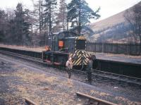 A track-lifting locomotive stands at Balquhidder station in December 1966. It was here in the early hours of 27th September 1965 that the 12.30 am Stirling-Oban train was halted after reports of a landslide to the north in Glen Ogle. Following an engineers' inspection the decision was eventually taken that the landslip was too serious to remove, just five weeks before the scheduled closure of the route.<br> <br><br>[Frank Spaven Collection (Courtesy David Spaven)&nbsp;/12/1966]