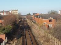 There is little trace these days of the four tracks that used to pass through Ansdell and Fairhaven, the houses on the right of this picture having been built on the old trackbed. This view looks west from a modern footbridge and the remaining face of the island platform can be seen beyond the road bridge. Unfortunately the scheduled service to Blackpool South did not appear for the picture. <br><br>[Mark Bartlett&nbsp;22/02/2010]