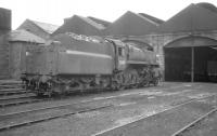 BR Standard class 4 2-6-0 no 76000 stands outside Motherwell shed c 1966.<br><br>[K A Gray&nbsp;//1966]