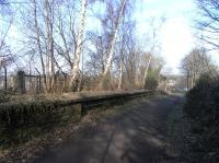 The site of Murrayfield station, looking north, on 20 February.� A <br> fragment of fencing remains on the Down platform (left) which is <br> intact.� The Up platform has been broached to provide access and its <br> southern ramp has been cut off. <br> <br><br>[David Panton&nbsp;20/02/2010]