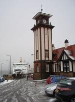 CalMac's <I>MV Argyle</I> prepares to leave a snowy Wemyss Bay for Rothesay, overlooked by the railway station's magnificent clock tower. <br><br>[Mark Bartlett&nbsp;25/02/2010]
