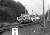 A DB track machine moving west from Bunde (Westfalen) in April 1976 on the main line towards Osnabruck. <br> <br><br>[John McIntyre&nbsp;/04/1976]
