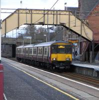 318 256 with a service for Dalmuir stands at Uddingston on 17 February 2010<br><br>[David Panton&nbsp;17/02/2010]