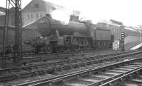 Gresley K2 no 61764 <I>Loch Arkaig</I> southbound on the up goods line through Springburn in July 1961. The K2 is taking a ballast train towards Sighthill Junction. The North British Locomotive Co Hyde Park works stands in the background. <br><br>[K A Gray&nbsp;03/07/1961]