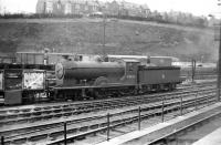 Scott class 4-4-0 no 62422 <I>Caleb Balderstone</I> in the yard at Hawick on 12 April 1958. The locomotive was withdrawn from Hawick shed at the end of that year.<br><br>[Robin Barbour Collection (Courtesy Bruce McCartney)&nbsp;12/04/1958]