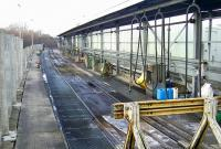 The present day fuelling facilities at Perth are located around the former platforms 8 and 9. This is a view of the 'half shed' and fuelling pumps installed a couple of years ago to handle the servicing of the Class 170s, including their associated CETs (Controlled Emission Tanks). Class 158's have all now been similarly adapted so the toilets can now be safely flushed in stations! The two stainless steel machines beyond the green wheeled bowser are two of the three CET pumps. Needless to say the latter are referred to in more colloquial terms locally.<br><br>[Gary Straiton&nbsp;26/02/2010]