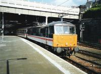 86 244 <I>The Royal British Legion</I> pulls out of platform 11 at Edinburgh Waverley in May 1997 with the 1710 service  to Birmingham New Street.<br><br>[David Panton&nbsp;/05/1997]
