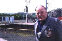 The Reverend Brydon Maben of Waverley Route fame, seen against a background of Border hills and Berwick's station platforms on 17th August 1993. [See image 18723]<br><br>[David Spaven&nbsp;17/08/1993]