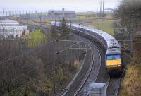 A northbound train on the ECML about to pass under Marshall Meadows road bridge on 27 February 2010, with Berwick-upon-Tweed in the background<br> <br><br>[Bill Roberton&nbsp;27/02/2010]