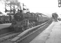 BR Caprotti standard class 5 4-6-0 no 73149 gets ready to leave Glasgow's Buchanan Street station in 1964 with a train for Dundee.<br><br>[K A Gray&nbsp;//1964]