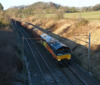 Colas Rail 66843 is now operating on its own on the Carlisle to Chirk log train. It is seen on 4 March 2010 heading south at Forton near Bay Horse. <br> <br><br>[John McIntyre 04/03/2010]