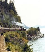 <I>Royal Hudson</I> 4-6-4 no 2860 heads south along the Pacific coast of British Columbia in 1988 shortly after leaving Squamish with a special returning to Vancouver. <br> <br><br>[John Furnevel&nbsp;//1988]