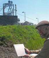 Artist Kenny Munro, from Craigmillar Community Arts Centre, with his sculpture at Newcraighall station on 29 May 2012. [See news item]<br> <br><br>[ScotRail&nbsp;29/05/2012]