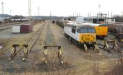 General view south over Warrington yard on 3 March 2010 with 56018 stabled alongside some yellow Network Rail coaches amongst various wagons. <br> <br><br>[John McIntyre&nbsp;03/03/2010]