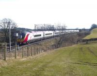 A northbound <i>Pendolino</i> at speed just south of bridge no 28 (Gretna to Westgillsyke Road) on the 09.30 London Euston to Glasgow Central at 12.55 on 10 March 2010. [See image 28054] <br><br>[Cyril Smith Collection (Courtesy Bill Jamieson)&nbsp;/03/2010]