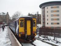 The passengers are already aboard as the driver of 156494 trudges back through the snow on Paisley Canal's platform. He will take the train back along the branch and on to Glasgow Central. <br><br>[Mark Bartlett&nbsp;25/02/2010]