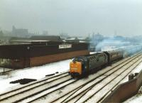 Deltic 55009 <I>Alycidon</I> runs through the Leeds suburb of Armley heading onto the Harrogate line to York, and then on to Hull via Selby, with The Deltic Executive special on a cold and snowy 29 December 1981. The special had reversed at Leeds after arrival from London Kings X, and would return from Hull to Kings X via Doncaster.<br><br>[David Pesterfield&nbsp;29/12/1981]