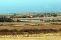 Spring time in Northumberland, an unidentified CrossCountry express races north near Alnwick on 7 March 2010.<br><br>[John Steven 07/03/2010]