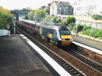 This September 1999 view at Inverkeithing was taken from the old <br> footbridge near the south end of the platforms.� It was removed a couple of years later when a fancier bridge with ramps and better accesses was built to the north.� The right-hand backgound has also changed a fair bit since, and of course GNER, the operator of this 125 to Aberdeen, is history too (as even is its successor). <br> <br><br>[David Panton&nbsp;/09/1999]