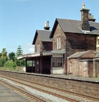 Thornhill station still retained its canopy in 1989 and had a 'just closed' feel to it despite its closure to passengers in 1965. The stonework has since been painted red and the building rennovated.<br><br>[Ewan Crawford&nbsp;//1989]