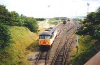 56 072 and a sibling faff about with coal wagons (if something so big can be said to faff, and if you can faff so slowly) on the Cockenzie branch in July 1995. The branch stops short of Cockenzie Power Station itself with the coal being carried into the site by a half-mile long conveyor. I'd imagine this was thought preferable to either an inconvenient level crossing over the coast road or roundabout rail route with expensive engineering works to avoid one.<br><br>[David Panton&nbsp;/07/1995]