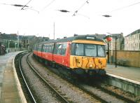 A service to Airdrie, formed by unit 303 065, calls at Partick in July 1997 <br><br>[David Panton&nbsp;/07/1997]