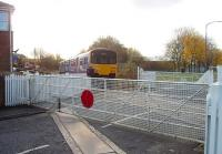 A Clitheroe to Manchester Victoria service, formed by Northern's 150149, passes through closed Daisyfield station as it approaches the junction with the East Lancashire line on the outskirts of Blackburn. The signal box here is still open but the level crossing gates are operated by hand. <br><br>[Mark Bartlett&nbsp;17/11/2009]