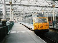 Edinburgh Waverley - 305 519 stands in the sunshine at the old North Berwick platform 7 (now 4) in April 1995.<br><br>[David Panton&nbsp;/04/1995]