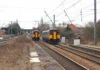 Multiple units pass on the slow lines at the south end of Leyland station on 13 March 2010. On the left is 156459 on a Blackpool North to Liverpool service, while on the right is 150207 arriving with the reverse working.<br><br>[John McIntyre&nbsp;13/03/2010]