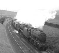 Stanier 8F no 48318 pilots Gresley V2 no 60813 on a southbound freight seen shortly after passing Beattock summit in the mid 1960s.<br><br>[Robin Barbour Collection (Courtesy Bruce McCartney)&nbsp;//]