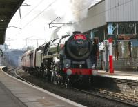 Britannia Pacific no 70013 <I>Oliver Cromwell</I> takes <I>The Roaring Monster</I> excursion north through Oxenholme on 19 March 2010 en route to Carlisle. <br><br>[John McIntyre&nbsp;19/03/2010]